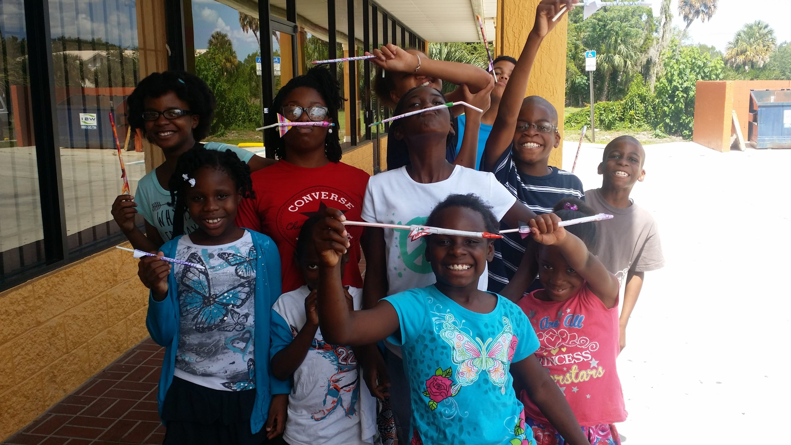 P.E.C. Summer STEM Camp. Students in front of Excellence Without Excuse (E-WE) Lab.