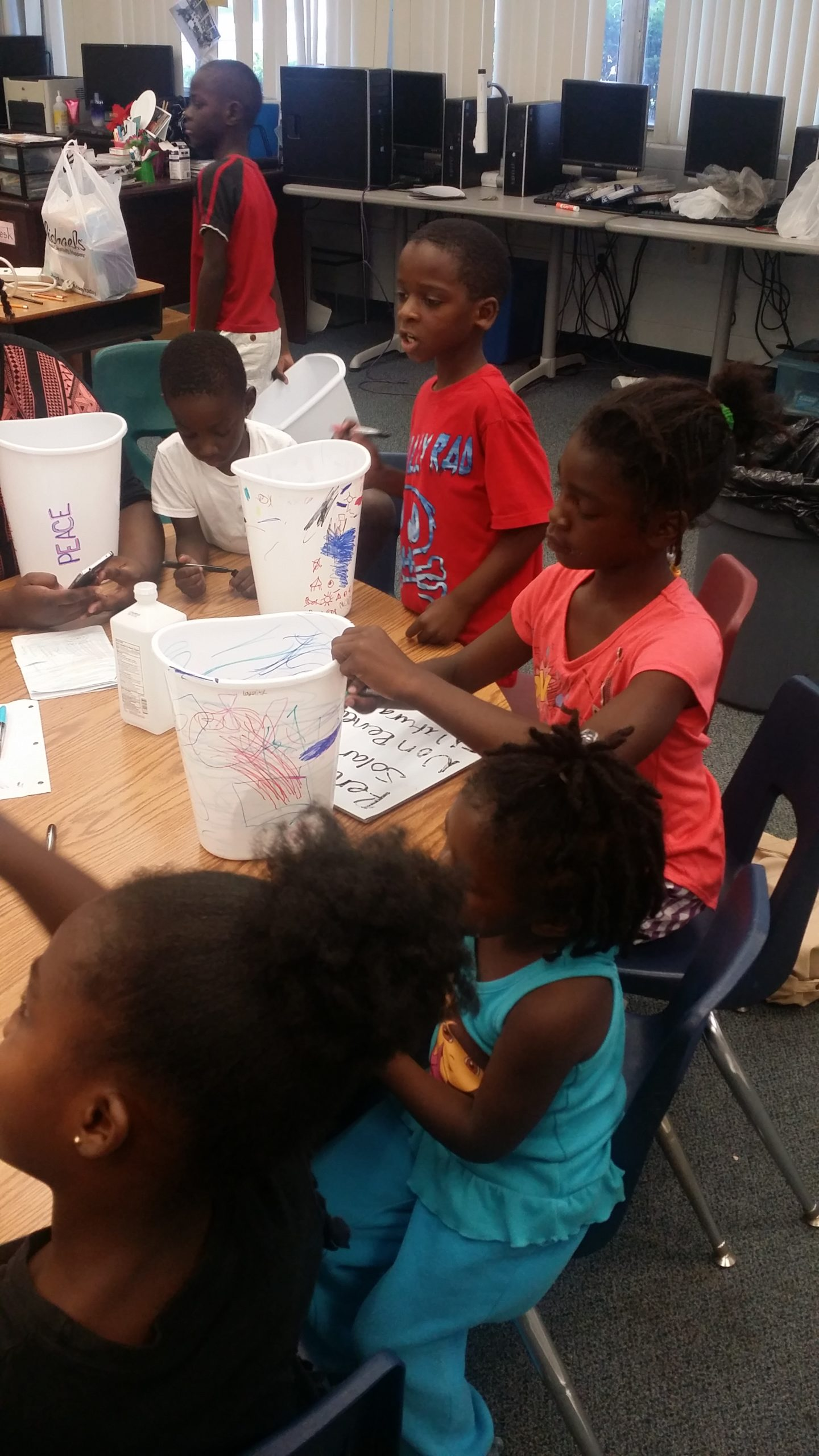 P.E.C.'s Excellence Without Excuse (E-WE) Lab. Students conducting science experiment.